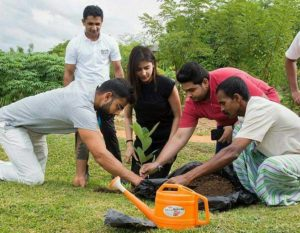 planting a sapling at the Aliya Resort and Spa in Sri Lanka 2